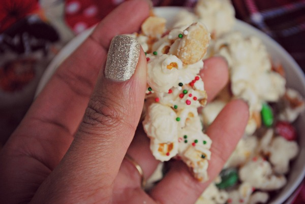 christmas crunch popcorn handful
