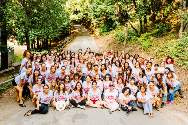 "group photo of women at summer camp, all wearing matching ""babes in the woods"" tshirts"